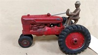 Cast iron tractor with driver. Made in the USA.
