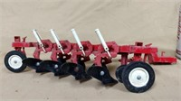 Red Ertl pull behind 4 bottom plow