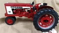 Farmall 504 Diesel tractor with damage.