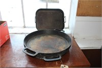 "Pair of 17"" cast iron griddles and roasting pan"