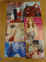 assorted Barbie collector books