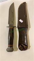 World war two era hunting knife, with a leather