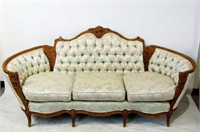 Antique French brocade sofa highly carved