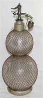 Early English Syphon Company London Double Gourd Seltzogene Soda Syphon.Circa 1890. Surmounted by a pewter cap and tap with drip cup and applied metal wire mesh net to the body. Height 50 cm.