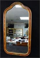 An Vintage gold framed mirror
