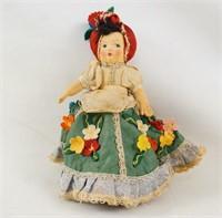 A vintage American folk topsy turvy doll