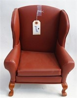 A Brown handmade doll wingback armchair