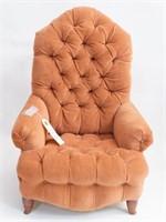 A handmade doll wingback armchair