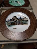 Box of nine Asian framed wall plates