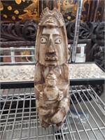 Brown marble aztec sculpture