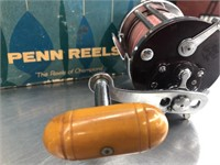Vintage fishing penn reel in case