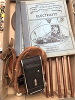 Box of vintage electrical books, camera etc