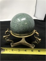 Marble sphere with brass dragon base