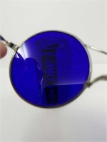 Pair of vintage blue lens sunglasses with glass