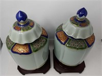 Pair of Asian ginger jars with wooden bases