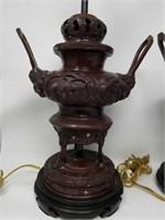 Pair of antique metal Asian lamps