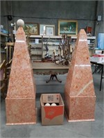 Pair of marble towers with spheres