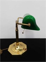 Metal desk lamp with green glass shade