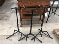 Group of three guitar stands