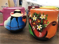 Group of hand painted mugs