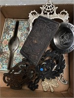 Box of vintage cast iron, tin tissue box, etc