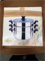 Stainless steel steamer with tempered glass lid.
