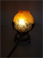 Antique bronze vanity lamp with art glass shade