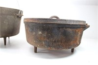 Two Cast Iron Dutch Ovens