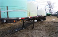 FLAT DECK 48 FT WITH4 WATER TANKS 83