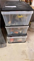 3 drawer organizer with sporting related items.