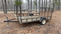 Single axle utility trailer with drop down ramp.