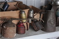 assortment of vintage oil cans