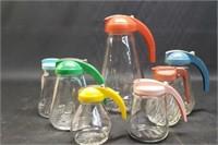 Set of condiment pourers
