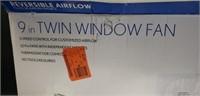 Like new 9 in twin window fan