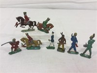 Cast iron figurines cowboys, indians and more