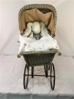 Antique wicker doll carriage w/bunny & blanket