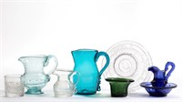 Sample of children's toys and diminutive blown jugs