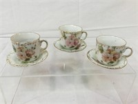 Hand-painted vintage childrens tea cups & saucers