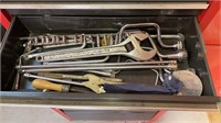 Craftsman roll around tool box loaded with tools.