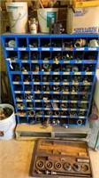 Parts bin full of fittings, valves, etc.