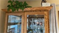 Custom built oak china cabinet with lighting and