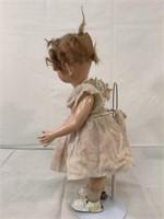 Vintage mechanical wind -up doll