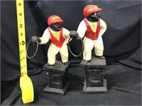 Two cast iron lawn jockeys