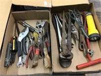 Tools including screwdriver, bolt cutters,