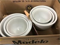Two sets of three piece nesting bowls