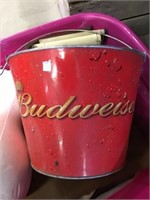 Tote of money bags, tape, Budweiser bucket