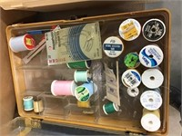 Three sewing boxes and sewing notions