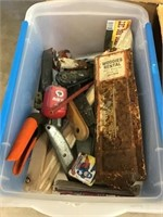 Tote of clippers, scrapers, rusted Woody's rental