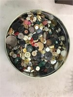 Tin of buttons