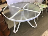 Aluminum patio table 47 x 27 1/2 and four metal